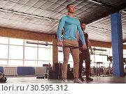 Купить «Fit Healthy Men Training Together in Gym.», фото № 30595312, снято 3 февраля 2019 г. (c) Pavel Biryukov / Фотобанк Лори