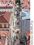 Aerial view of Lisbon downtown and Santa Justa Street to Sao Jorge Castle hill from panoramic platform of Elevador de Santa Justa or Miradouro de Sant (2018 год). Редакционное фото, фотограф Николай Коржов / Фотобанк Лори