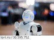 Купить «Head of toy robot on a blurred background», фото № 30595752, снято 15 апреля 2019 г. (c) Евгений Харитонов / Фотобанк Лори
