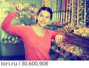Купить «Woman in sweets shop», фото № 30600908, снято 22 марта 2017 г. (c) Яков Филимонов / Фотобанк Лори
