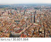 Купить «Aerial view of the roofs of the spanish city of Reus. Tarragona province. Catalonia. Spain», фото № 30601064, снято 17 января 2019 г. (c) Яков Филимонов / Фотобанк Лори