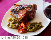 Купить «Broiled pork knuckle with vegetable garnish», фото № 30601088, снято 17 июля 2019 г. (c) Яков Филимонов / Фотобанк Лори
