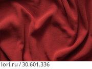 Купить «Texture of deep red fleece, top view», фото № 30601336, снято 5 апреля 2019 г. (c) EugeneSergeev / Фотобанк Лори