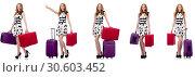 Купить «Beautiful woman in polka dot dress with suitcases isolated on wh», фото № 30603452, снято 22 апреля 2019 г. (c) Elnur / Фотобанк Лори