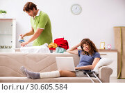 Купить «Husband helping leg injured wife in housework», фото № 30605584, снято 4 октября 2018 г. (c) Elnur / Фотобанк Лори