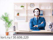 Купить «Male employee in the office in industrial espionage concept», фото № 30606220, снято 7 декабря 2018 г. (c) Elnur / Фотобанк Лори