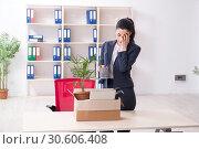 Купить «Young female employee being fired from her work», фото № 30606408, снято 15 января 2019 г. (c) Elnur / Фотобанк Лори