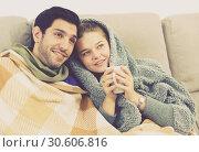 Купить «Couple together under blanket watching TV», фото № 30606816, снято 12 ноября 2019 г. (c) Яков Филимонов / Фотобанк Лори