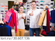 Купить «couple boasting various purchases in sports store», фото № 30607136, снято 22 ноября 2016 г. (c) Яков Филимонов / Фотобанк Лори
