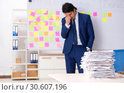 Купить «Young handsome employee in front of whiteboard with to-do list», фото № 30607196, снято 16 октября 2018 г. (c) Elnur / Фотобанк Лори