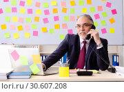 Купить «Aged man employee in conflicting priorities concept», фото № 30607208, снято 25 декабря 2018 г. (c) Elnur / Фотобанк Лори
