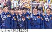 Купить «Russia, Samara, May 9, 2018: Girls from the cadet school at the parade. Russian text: Cadet school», фото № 30612708, снято 9 мая 2018 г. (c) Акиньшин Владимир / Фотобанк Лори