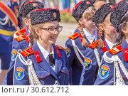 Купить «Russia, Samara, May 9, 2018: Cadets of the Volga Cossack troops at the parade. Russian text: Volga Cossack army», фото № 30612712, снято 9 мая 2018 г. (c) Акиньшин Владимир / Фотобанк Лори
