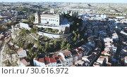 Купить «Aerial view of impressive medieval castle of Order of Calatrava on hill in town of Alcaniz, Spain», видеоролик № 30616972, снято 26 декабря 2018 г. (c) Яков Филимонов / Фотобанк Лори