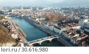 Купить «Aerial view Grenoble of city center with embankment of Isere river, France», видеоролик № 30616980, снято 5 января 2019 г. (c) Яков Филимонов / Фотобанк Лори