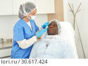 Купить «Professional woman doctor examining patient before procedure in clinic», фото № 30617424, снято 30 марта 2019 г. (c) Яков Филимонов / Фотобанк Лори