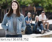 Positive teenager girl smiling and standing. Стоковое фото, фотограф Яков Филимонов / Фотобанк Лори