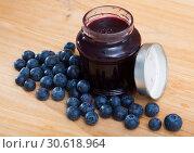 Купить «Tasty blueberry jam in jar and fresh berries on wooden surface», фото № 30618964, снято 15 октября 2019 г. (c) Яков Филимонов / Фотобанк Лори