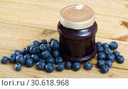 Купить «Tasty blueberry jam in jar and fresh berries on wooden surface», фото № 30618968, снято 19 июня 2019 г. (c) Яков Филимонов / Фотобанк Лори