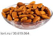 Купить «Image of roasted salt almonds on glass bowl, nobody», фото № 30619064, снято 17 июля 2019 г. (c) Яков Филимонов / Фотобанк Лори