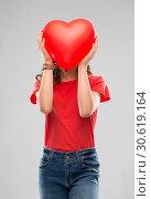 Купить «teenage girl with red heart shaped balloon», фото № 30619164, снято 17 февраля 2019 г. (c) Syda Productions / Фотобанк Лори