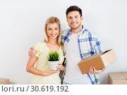 Купить «couple with box and flower moving to new home», фото № 30619192, снято 25 февраля 2016 г. (c) Syda Productions / Фотобанк Лори