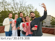 friends with drinks taking selfie at rooftop party. Стоковое фото, фотограф Syda Productions / Фотобанк Лори
