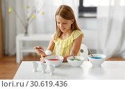 Купить «girl coloring easter eggs by liquid dye at home», фото № 30619436, снято 25 июля 2018 г. (c) Syda Productions / Фотобанк Лори