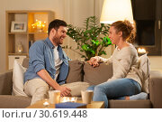 Купить «happy couple talking at home in evening», фото № 30619448, снято 5 января 2019 г. (c) Syda Productions / Фотобанк Лори