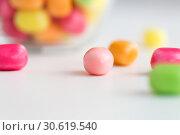 Купить «close up of candy drops over white background», фото № 30619540, снято 6 июля 2018 г. (c) Syda Productions / Фотобанк Лори