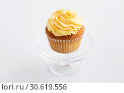 Купить «cupcake with frosting on confectionery stand», фото № 30619556, снято 6 июля 2018 г. (c) Syda Productions / Фотобанк Лори