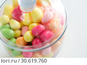 Купить «close up of glass jar with colorful candy drops», фото № 30619760, снято 6 июля 2018 г. (c) Syda Productions / Фотобанк Лори