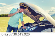 Купить «man with broken car calling on smartphone», фото № 30619920, снято 12 июня 2016 г. (c) Syda Productions / Фотобанк Лори