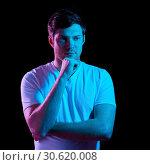 Купить «thinking man over neon lights in dark room», фото № 30620008, снято 3 февраля 2019 г. (c) Syda Productions / Фотобанк Лори