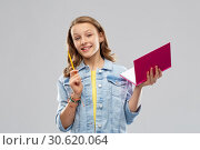 Купить «teenage student girl with diary or notebook», фото № 30620064, снято 17 февраля 2019 г. (c) Syda Productions / Фотобанк Лори