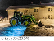 Купить «Removing snow at night in the fishing village of Reine in the Lofoten Islands, Arctic, Northern Norway. A week earlier the islands were paralyzed by the most snow to fall in 25 years.», фото № 30623640, снято 7 февраля 2019 г. (c) age Fotostock / Фотобанк Лори