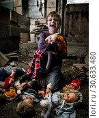 Creepy boy and scary clown doll in the barn. Стоковое фото, фотограф sumners / easy Fotostock / Фотобанк Лори