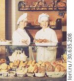 Купить «Smiling women selling fresh pastry and loaves», фото № 30635208, снято 25 июня 2019 г. (c) Яков Филимонов / Фотобанк Лори