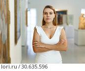 Купить «Woman visiting painting exhibition», фото № 30635596, снято 28 июля 2018 г. (c) Яков Филимонов / Фотобанк Лори