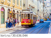 Купить «One of the most famous and historical electric tram of No. 28 running on the fancy street. Lisbon, Portugal», фото № 30636044, снято 15 июля 2018 г. (c) Николай Коржов / Фотобанк Лори