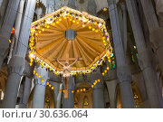 Купить «Interior of Holy Family Cathedral in Barcelona, Catalonia, Spain», фото № 30636064, снято 5 апреля 2018 г. (c) Наталья Волкова / Фотобанк Лори