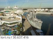 Купить «The Victory Ship America LIberty is a museum liberty ship of the world war II effort and sits in the Tampa Florida harbor and the cruise ship docks.», фото № 30637416, снято 17 января 2019 г. (c) age Fotostock / Фотобанк Лори