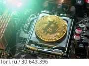 Купить «Golden physycal bitcoin. Business concept of digital cryptocurrency. Blockchain technology and bitcoin mining», фото № 30643396, снято 4 апреля 2019 г. (c) Зезелина Марина / Фотобанк Лори