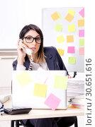 Купить «Young female employee in conflicting priorities concept», фото № 30651616, снято 21 января 2019 г. (c) Elnur / Фотобанк Лори