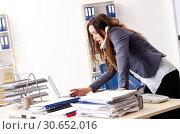 Купить «Young female employee unhappy with excessive work», фото № 30652016, снято 6 ноября 2018 г. (c) Elnur / Фотобанк Лори