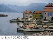 Купить «Fishing boat moored on port in fishing village, Karce, Trivet, Montenegro», фото № 30653692, снято 20 июля 2019 г. (c) Ingram Publishing / Фотобанк Лори