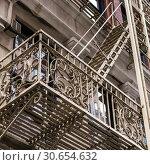Купить «Low angle view of fire escape on apartment building, Lower Manhattan, New York City, New York State, USA», фото № 30654632, снято 13 декабря 2019 г. (c) Ingram Publishing / Фотобанк Лори