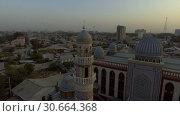Купить «Съёмка мечети с коптера. Душанбе, Таджикистан.», видеоролик № 30664368, снято 31 июля 2016 г. (c) kinocopter / Фотобанк Лори