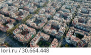 Купить «Aerial view of Barcelona cityscape with peculiar geometric grid of Eixample district», видеоролик № 30664448, снято 16 ноября 2018 г. (c) Яков Филимонов / Фотобанк Лори