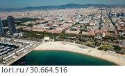 Купить «Modern cityscape of Barcelona on background with water surface of Mediterranean», видеоролик № 30664516, снято 24 июля 2018 г. (c) Яков Филимонов / Фотобанк Лори